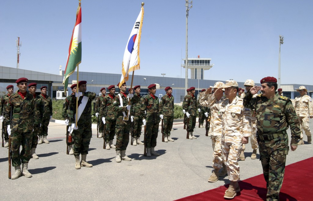 Iraq's Minister for Peshmerga Affairs in the Kurdistan region Omar and South Korea's Chairman of the Joint Chiefs of Staff General Kim salute in Arbil